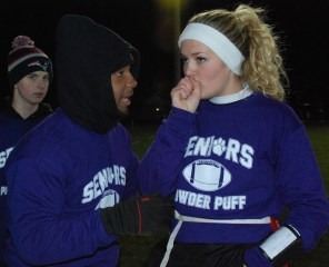 Senior coach, Leshon Crawford talks to quarterback, Brianna Starkey
