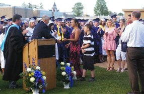 Kyra Rose receives her brother Josh Rose's diploma from Richard Phelps, chairman of the Rockland School Committee. Josh passed away this year.
