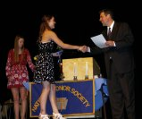 Senior Mekenzie Levesque receives her NHS certificate from Principal Alan Cron. NHS President Danielle Whitcher (left) conducted the ceremony.