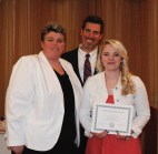 Junior Haley Macray receives the Journalism Achievement Award from Asst. Principal Kathy Paulding and Principal Alan Cron. Macray is the editor of the Veritas on-line edition.