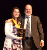 Alyssa Collins receives the Valedictorian Award from Superintendent of Schools, John Retchless.