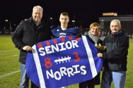 Stephen Norris escorted by his parents Michelle and Mark and his grandfather, Dan