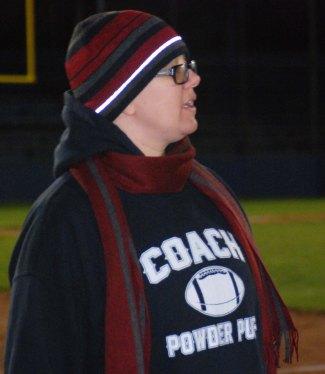 Coach Samantha Hoyo looks on.