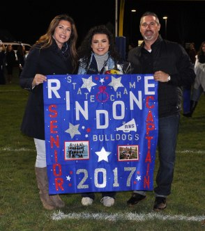 Captain Talia Rindone with her parents Daria and Guy