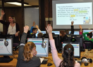 Mrs. Lisa Ryan, technology instructor, leads the lesson in the 3rd grade computer class at Esten Elementary School.