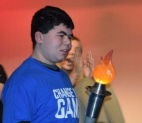 Alex Anzivino carries the ceremonial torch to kick off the MASC Special Olympics Bocce tournament hosted by Rockland's student government council on Sunday, Jan. 29. photo by Maddie Gear