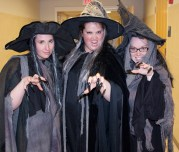 Mrs. Shaugnessy, Ms. White and Ms. Fagan casting a spell in their witchy robes.