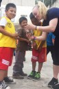 Olivia Solletti shows her phone to the children. Courtesy photo