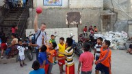 Mo Youssef was a popular figure at a school in San Jorge, a mountain town in Guatemala, with the village children who rarely see someone that tall! photo courtesy of Mr. Connors