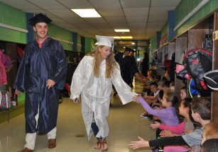 Adam Royle and Sydney Ferguson greet the elementary school children at Esten Elementary School