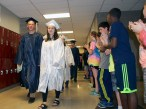 Jeffre Donahue and Erin Buckley were two of many seniors who visited their former schools. Here they walk through Rogers Middle School