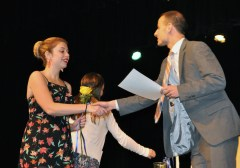 Sydney Wells receives a certificate from Mr. Harrison