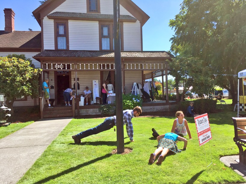 """The Gordon Family YMCA had a """"prize"""" wheel like no other that got kids doing push-ups on the Ryan House lawn."""