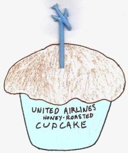 A cupcake with a festive plane-on-a-stick in it.