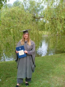 Me holding my BA certificate shortly after graduating.