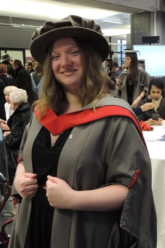 Me in my grad robes, closer up.