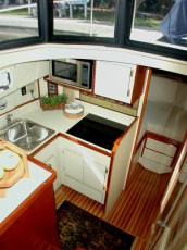 Galley with electric cooktop and additional upper cabinet