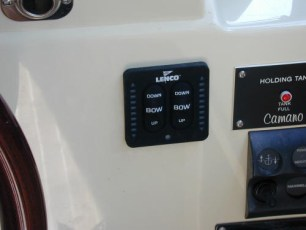 Trim tab controls at lower helm