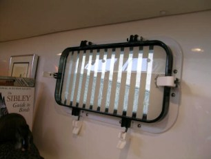 Hunter-Douglas honey combed shades on aft cabin port lights