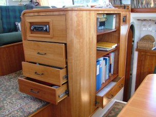 Modifying cabinet for additional drawers and storage shelves