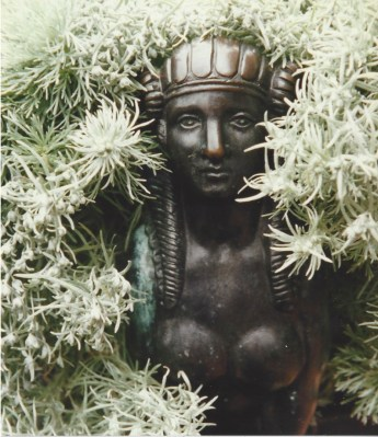 A bust is framed by silvery foliage at Sissinghurst