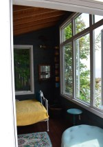 The breezy bunkie features large windows.