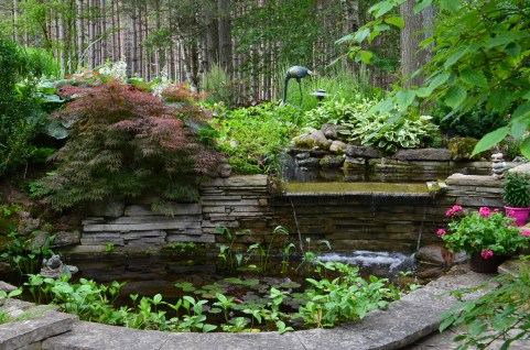 The pond's stonework gives the water feature a natural look.