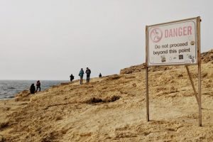 zoloft and alcohol danger sign on beach