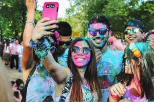 sober socializing people covered in colored powder