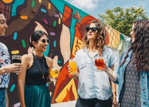 moderate drinking women talking and holding beer