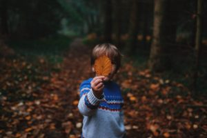 connection between addiction and childhood trauma boy holding leaf