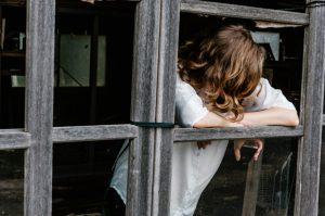 mental health apps woman in wooden door frame