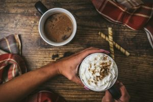 sober holidays woman holding hot cocoa