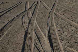 tire tracks winding through the sand sneaky things that can undermine you