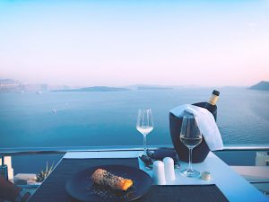dating an alcoholic, two wine glasses overlooking water