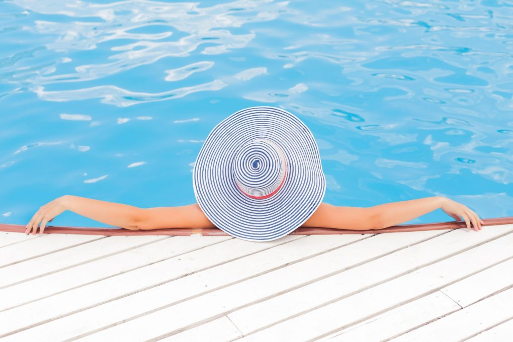 woman relaxing in pool, rehab from home