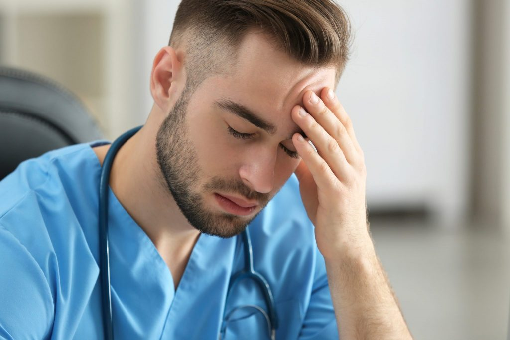 Male ER nurse experiencing stress, sample Ria member