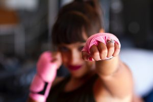 woman with pink boxing gloves alcohol and breast cancer