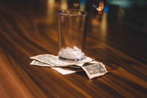 money under beer glass how much money do people spend on alcohol