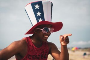 man in funny hat on beach drunk personalities
