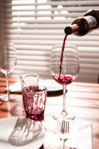 pouring wine, early signs of liver damage from alcohol