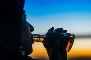 man drinking whiskey, how to reduce drinking