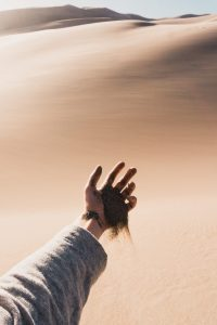 sand through hand dry drunk