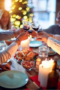 family toasting glasses, coping with family drinking at holiday gatherings