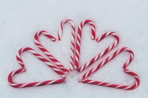 candy canes on snow, holiday heart syndrome