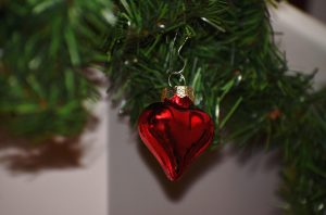 heart ornament on tree, holiday heart syndrome