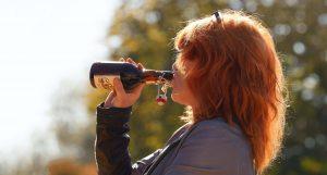 woman drinking beer maladaptive behavior