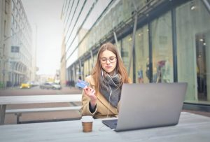 woman on computer with credit card