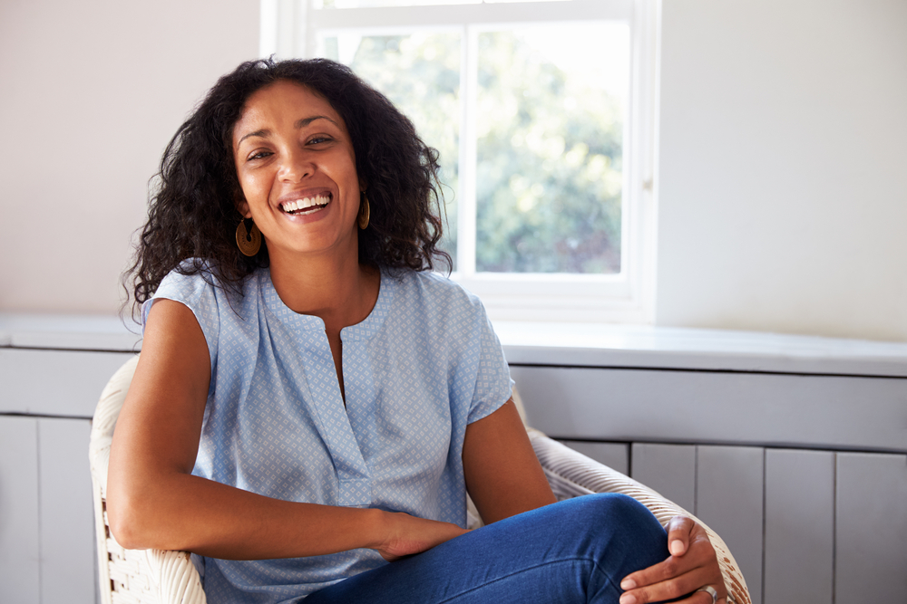 woman sitting in chair and smiling