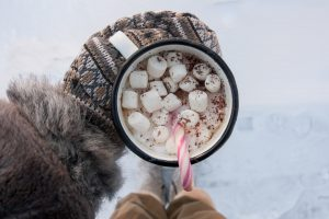peppermint hot chocolate mug in the snow